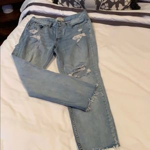Free people ripped jeans.